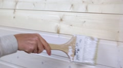Woman painting wooden slot and key boards in white color Stock Footage