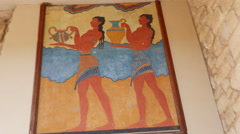 Greece Crete Knossos painting of men in ruin Stock Footage