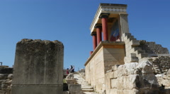 Greece Crete Knossos restored ruin side view with tourists Stock Footage