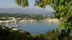 Greece Crete leaves frame Bay of Kalyvia Stock Footage