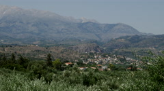 Greece Crete olive groves and village houses with mountains Stock Footage