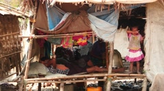 Poor adult people and children in hut near Yangon of Myanmar 2 Stock Footage