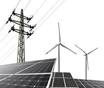 Solar energy panels with wind turbines and electricity pylon - stock photo