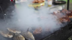 Barbecue With Delicious Grilled fish On Grill. Smoke close up Stock Footage
