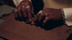 Black man twisting cigars closeup Stock Footage