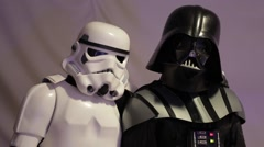 Stormtrooper and Darth Vader posing for a photo shoot. Star Wars. Stock Footage