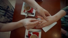 Man Putting Ring on Girl's Finger in cafe Stock Footage