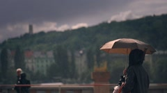 Street. Girl standing under an umbrella, the rain. Past rides the bus. Stock Footage