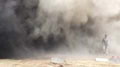 Stunt girl in a fiery explosion. Slow motion. Stock Footage