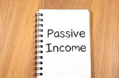 Passive income write on notebook - stock photo