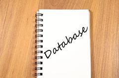 Database write on notebook - stock photo