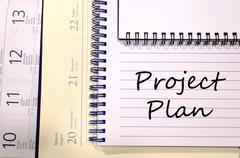 Project plan write on notebook Stock Photos