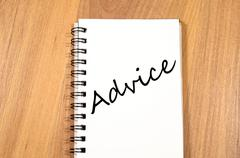 Advice write on notebook - stock photo