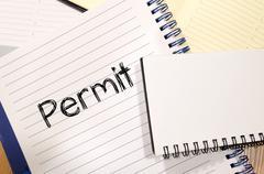 Permit write on notebook Stock Photos