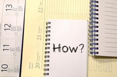 How write on notebook - stock photo
