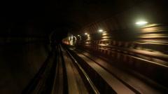 Camera Moves Backward along Metro Rails in Dark Tunnel - stock footage