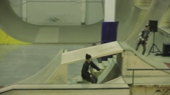 Boy make extreme slip on fence, hard collision with other roller skater in skate - stock footage
