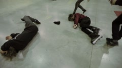 People come to boys lie on floor after hard collision in skate park. Roller - stock footage