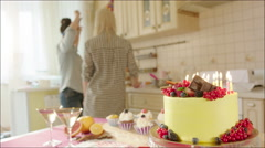 Two girls celebrating birthday at home party - stock footage