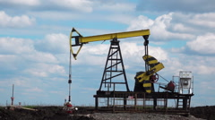 Working Oil Pump at blue sky zoom out Stock Footage