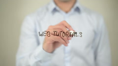 Web Tutorials , man writing on transparent screen Stock Footage