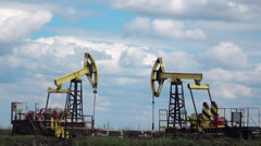 Working Oil Pumps  at blue sky zoom in Stock Footage