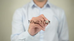 Newsletter , man writing on transparent screen Stock Footage