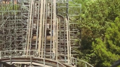 Riding on roller coaster in amusement park. Extreme. Joyfulness. Summer sunny Stock Footage