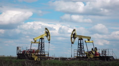 Working Oil Pumps at blue sky time lapse Stock Footage