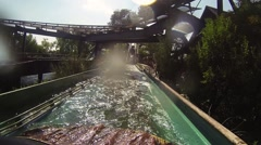 Boat floats on water roller coaster in amusement park. Wagon. Attraction Stock Footage
