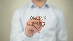 Online Gaming , man writing on transparent screen Stock Footage