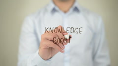 Knowledge Boost , man writing on transparent screen Stock Footage