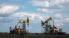 Working Oil Pumps at blue sky real time Stock Footage