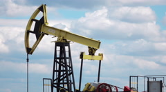 Working Oil Pump at blue sky time lapse Stock Footage