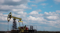 Working Oil Pump at blue sky zoom in Stock Footage