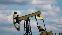 Working Oil Pump at blue sky real time Stock Footage