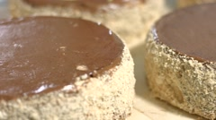 Blank cakes with chocolate top. Stock Footage