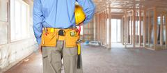 Construction worker with a tool belt. - stock photo