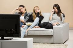 Watching sad movies Stock Photos