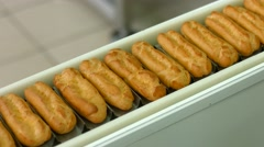 Eclairs quickly moving on conveyor. - stock footage