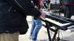 Keyboard player playing music during concert, band performing song at festival - stock footage