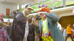 Clown with photocamera taking picture at carnival 4K Stock Footage