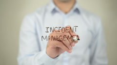 Incident Management , man writing on transparent screen Stock Footage