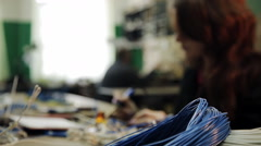 Girl solder the cable to the connector Stock Footage