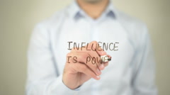 Influence Is Power , man writing on transparent screen - stock footage