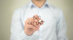 Bad Credit , man writing on transparent screen Stock Footage