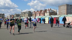 People running for the Brighton marathon Stock Footage