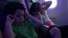 Kids protecting their ears during landing - stock footage