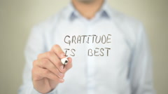 Gratitude Is Best Attitude , man writing on transparent screen Stock Footage
