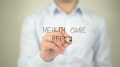 Health Care Reform , man writing on transparent screen Stock Footage